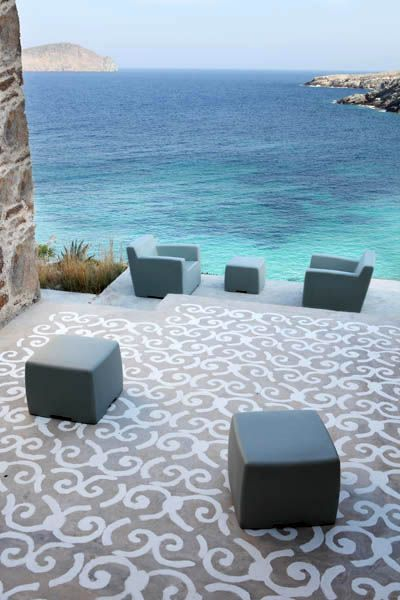 Greece | Paola Navone- I don't know if the flooring is brick or cement but it does look like it's stenciled over-god idea for inside or outside