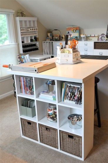 Love the storage at the end of the table in this scrapbook room