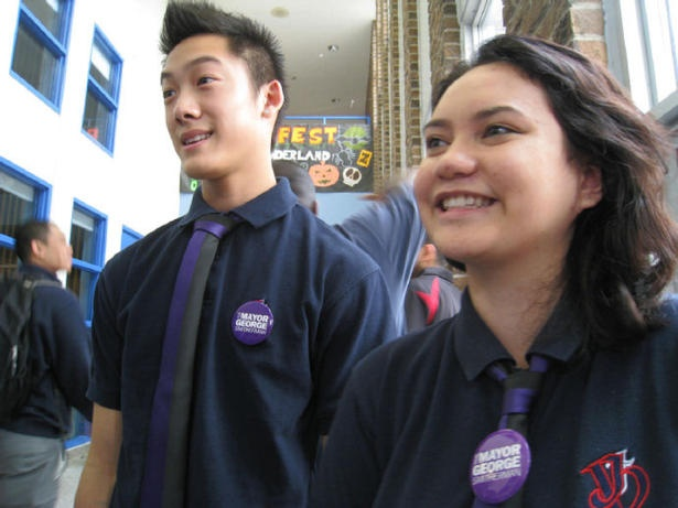 Wearing George Smitherman buttons, Phong Tran and Kourtney Valdez-Scott work the corridors of Toronto's Jean Vanier Catholic Secondary School to raise awareness Oct. 21 of municipal election issues. The students were part of the province-wide Student Vote project.