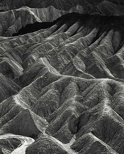 In a strict sense photography can never be abstract, for the camera is incapable of synthetic integration. - Ansel Adams,1932