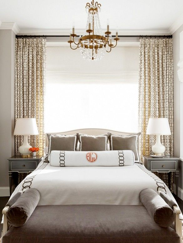 bed against window with roman blinds and curtains - Jenny Wolf Interiors in Chelsea