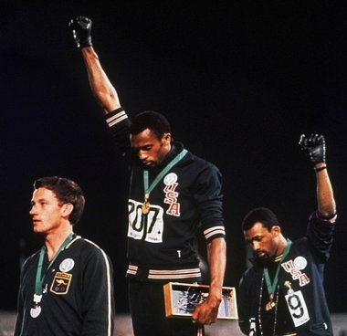 Even though, Peter Norman was the fifth fastest sprinter in the world in 1972 (still holds Australia's record),was banned from the 1972 Olympics for supporting his fellow sprinters, his career was effectively over. He was offered the chance to condemn Smith and Carlos many times over the next decades, and refused to. In 2012, the Australian Parliament passed a motion which appologised to Norman for the treatment he received upon his return to Australia. Smith and Carlos were pallbearers.