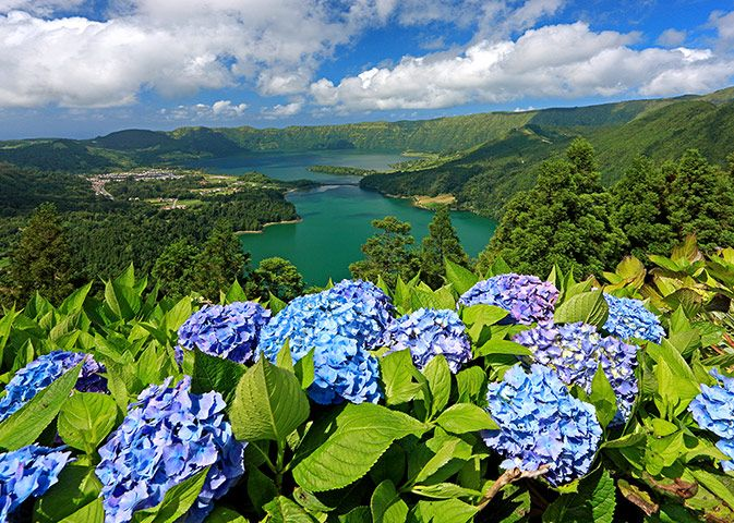 SunvilAzores: Caldeira das Sete Cidades,  São Miguel  The Azores: 12 must-see highlights - in pictures This archipelago of nine lush green islands in the Atlantic ocean is teeming with dramatic vistas, extraordinary wildlife and architectural gems. From spectacular geysers and volcanic landscapes to picturesque villages and charming towns,  Whether you explore one island, or spend your time hopping between several, there are plenty of activities to enjoy