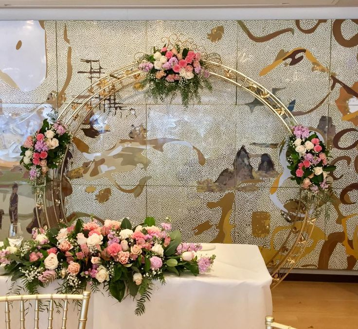 round archway and florals created by Lovely Bridal Blooms  arch elegant tea time and events