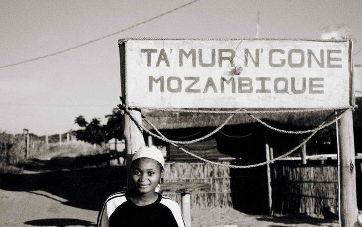 A #mozambican lady outside of a tavern