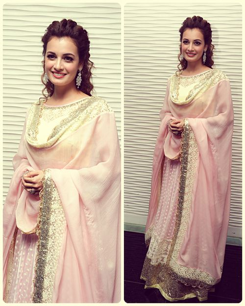 Diya mirza is looking marvelous in a pink floor length anarkali. Bollywood fashion. Indian fashion.