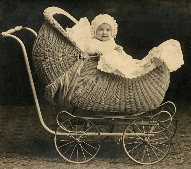 Baby in a wicker pram