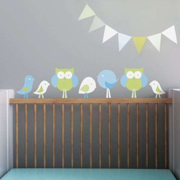 cute owl wall decals for children's nursey // I really like the idea of using the crib as part of the art.