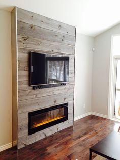 fireplace feature wall completed with grey reclaimed barn board supplied by barnboardstorecom - Tv Wall Design Ideas