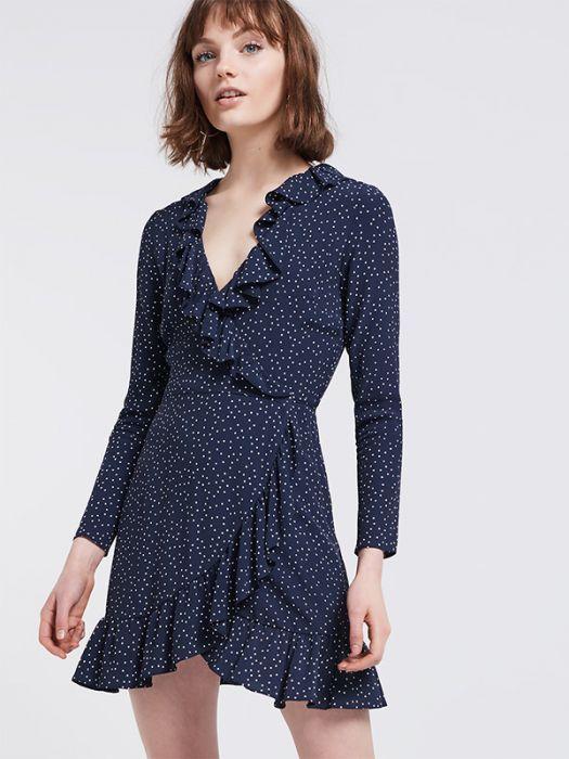 <p>Navy Ria Dot Ruffle Wrap Dress</p>