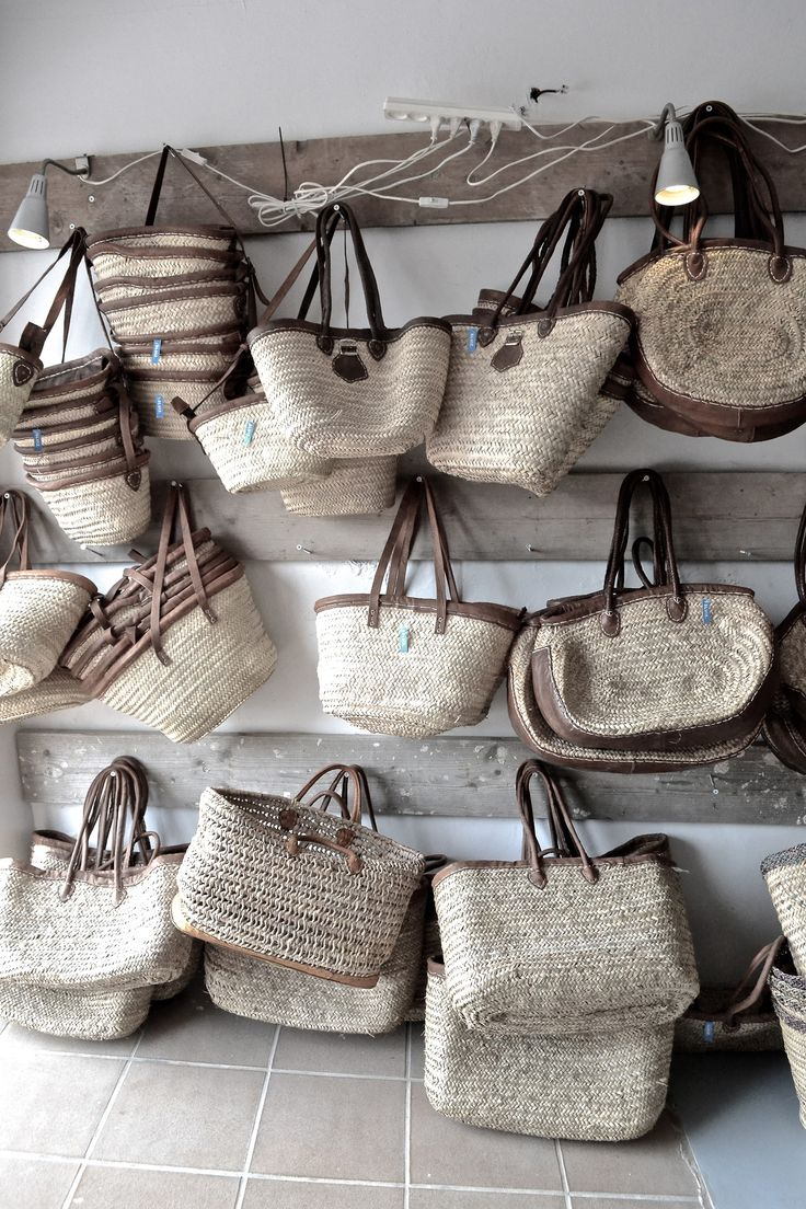 Woven totes with fabric details and leather handles.