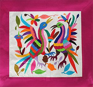 Otomi textiles originate from the indigenous Otomi people of Hidalgo and Queretaro, Mexico. An ancient craft using hand embroidering techniques, Otomi textiles, known as tenangos, incorporate colorful images of animals and native people. The real and mystical imagery of the textiles depict the Otomi cosmovision originally recorded in regional cliff drawings.