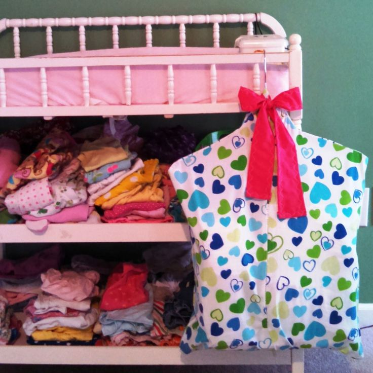 http://www.athomeinthewilburness.com/how-to-make-a-diaper-stacker-out-of-a-pillowcase/