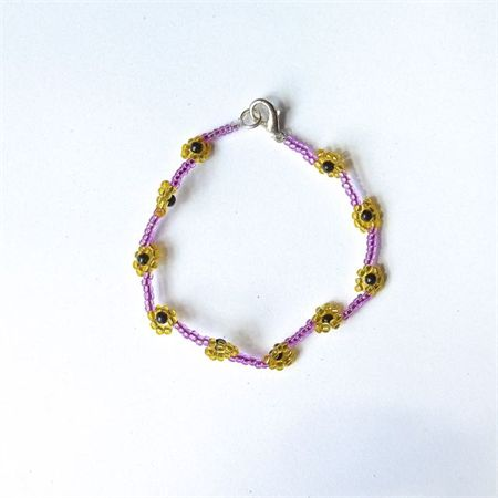 Woven Beaded Flower Bracelet: Purple and Yellow. Available to purchase from Breeze Creations on Madeit