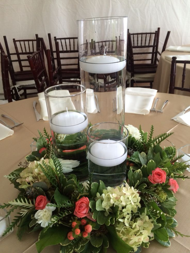 Floating candle centerpiece with floral ring. Coral and white.