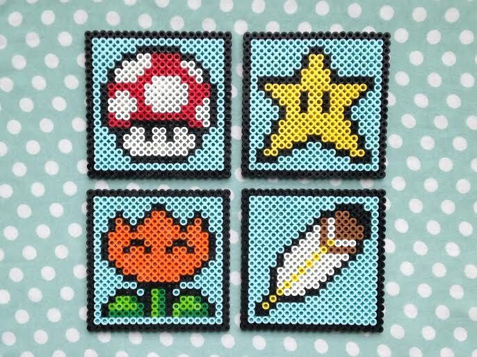 Super Mario World Items Inspired Video Game Perler Bead Coasters Set of Four by PorcupineSpines on Etsy https://www.etsy.com/listing/162184786/super-mario-world-items-inspired-video