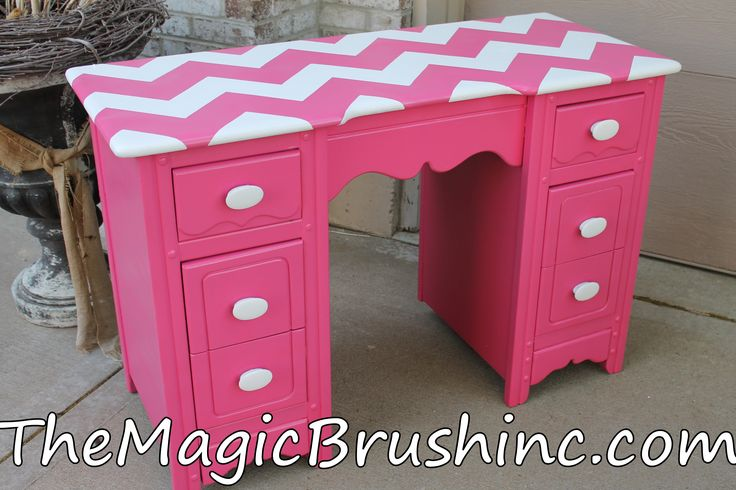 Jennifer's tip: Improve a boring piece of furniture with a fun, bold pattern and stylish handles. This repainted hot pink desk with chevron top now pops with color. themagicbrushinc.com
