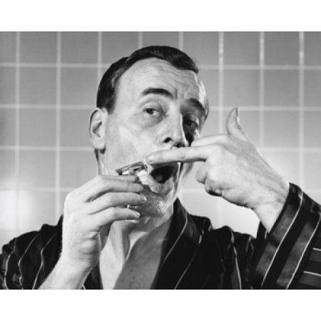 Close-up of a mature man shaving Canvas Art - (18 x 24)