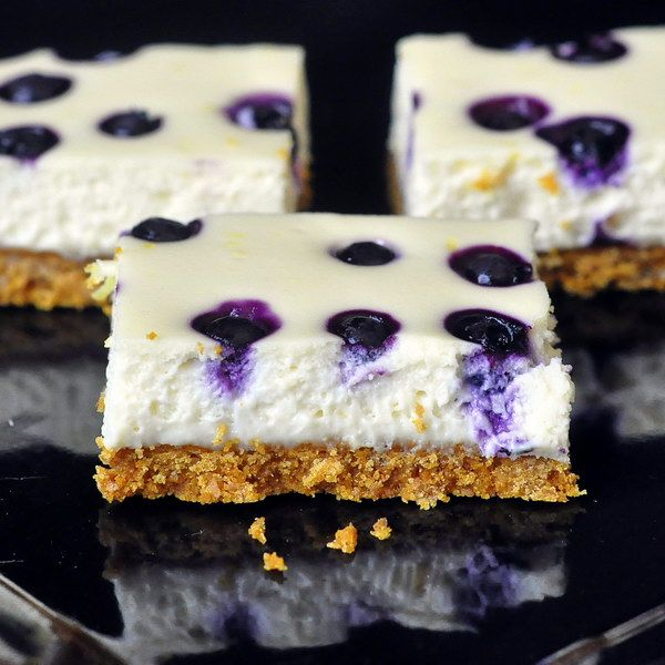 Lemon Blueberry Cheesecake Dessert Bars - when just a little cheesecake is enough, these beautiful dessert bars make a perfect mid-week treat...and they freeze well too!
