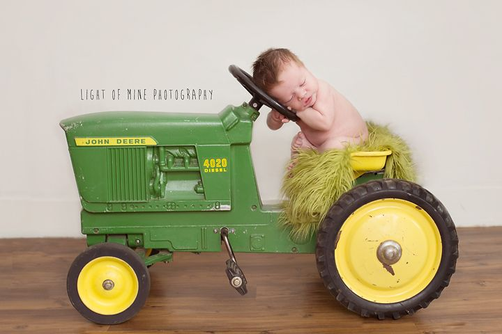 Light of Mine Newborn Photography   baby on tractor need baby girl in Orange on brothers tractor