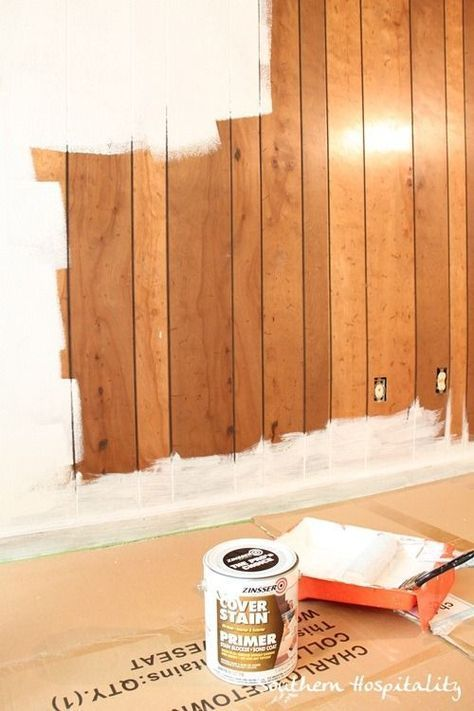 Painting old paneling to update and freshen.