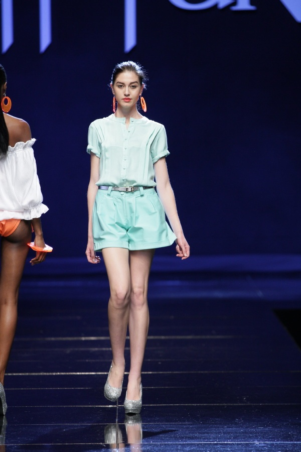 Pleated blue blouse with rolled sleeves and blue wide legged shorts