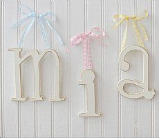 Spell out your child's name or a favourite phrase with any of our baby letters. Choose from over 50 different unique ribbons for our wooden letters for babies room and a variety of backgrounds for our Framed Letters.  Baby room wall letters are a great personalise gift for a new baby!