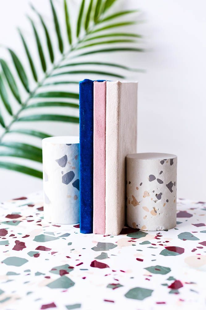 """Hello, terrazzo: The forgotten flooring of the '70s is brightening up ceilings, entryways and everything in between (saves for """"terrazzo"""" +316% on Pinterest). Here's how to Create a Terrazzo Print on Almost Anything PLUS DIY Terrazzo Concrete Book Ends."""