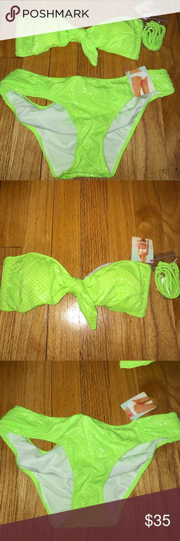 Victoria's Secret neon green sparkly bathing suit Victoria Secret bathing suit set; bandeau and bottoms. Top is a belle bandeau in size x-small and bottoms are hipkini fit in size small. NEGOTIABLE Victoria's Secret Swim Bikinis