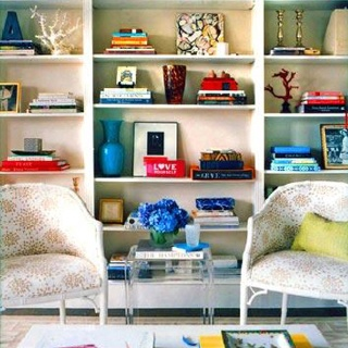 Colorful bookshelf styling ( via Domino Mag)…