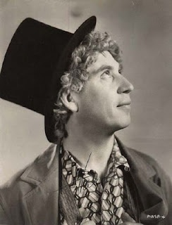 "Adolph ""Harpo"" Marx (later Arthur ""Harpo"" Marx) (November 23, 1888 – September 28, 1964) was an American comedian & film star. He was the second-oldest of the Marx Brothers. He wore a curly reddish blonde wig, and never spoke during performances. He blew a horn or whistled to communicate and frequently used props, and he played the harp in most of his films. ""She's a lovely person. She deserves a good husband. Marry her before she finds one."""