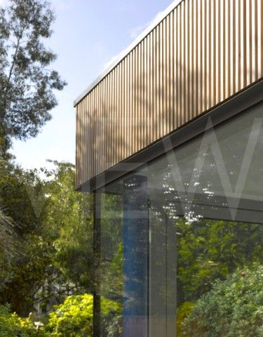 glass corner meets concertina doors