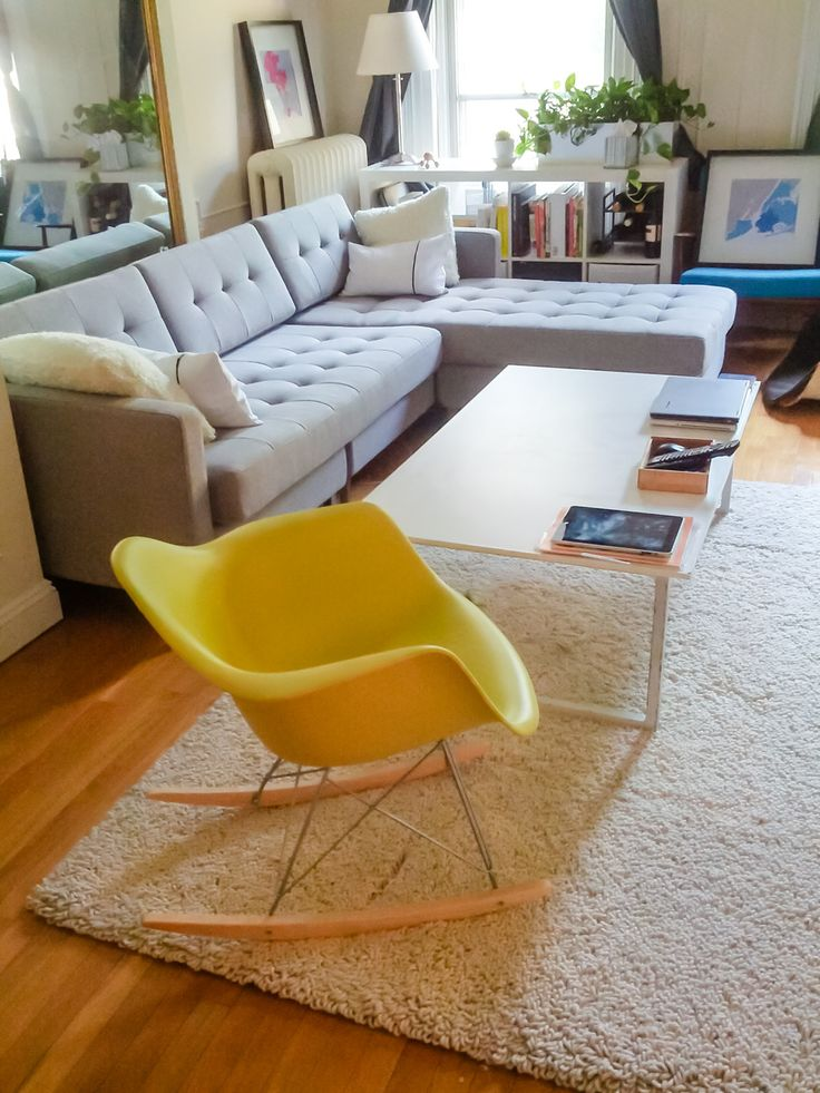 My living room: Eames Rocker, Kofors Jensen Chair (blue in corner), and a CB2 sectional. Rug from Room and Board, custom corian coffee table.