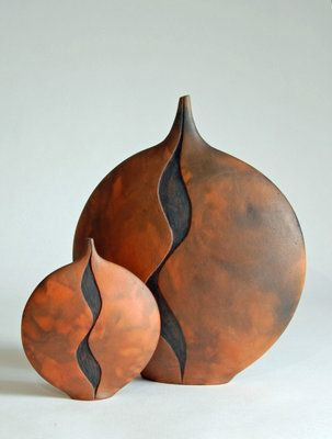 Ann Wilson | Slab built & carved vessels, 25.5 cm & 16 cm. Smoke fired with leaves and newspaper.