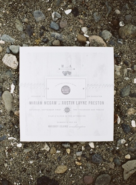 peaceful-seaside-wedding-inspiration-stones-paper-goods
