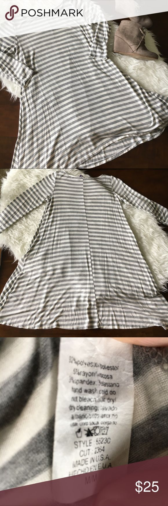 "Gray and White Striped Swing Dress/ Tunic Excellent used condition. Super soft gray and white 3/4 sleeve striped swing dress. Can be worn alone, or with leggings or skinny jeans and booties for a cute fall look! Size medium. Approx measurements: armpit to armpit: 17 1/2"", shoulder to hem: 32"", sleeve length: 12 1/2"". No tears, holes, or stains. Smoke free home. No trades please. Dresses"