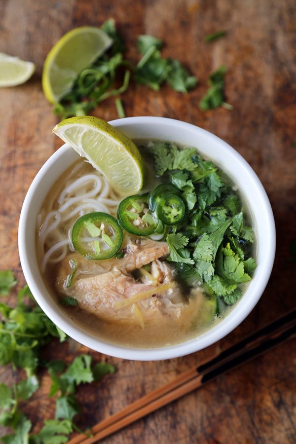 Vietnamese chicken noodle soup from:pickledplum.com - 1 quart low sodium chicken stock - 2 tbsp ginger, cut into thin strips - leftover roasted chicken (about 2 cups, with skin) - 2 tbsp fish sauce -1/2 cup cilantro, finely chopped -1 jalapeno, thinly sliced -rice noodles or ramen noodles (your preference) - lime segments: