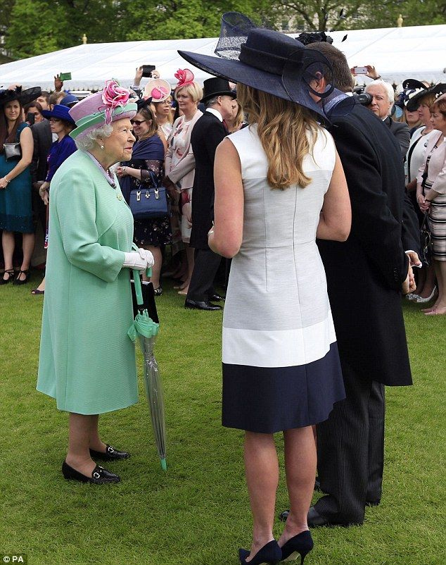 The Queen chats with guests during the party at Buckingham Palace today, less than 24 hours after the breach