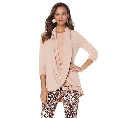 We want (need!) this Sweater with Attached Scarf ($59.90) in all three colors it comes in. http://thestir.cafemom.com/beauty_style/190692/serena_williams_debuts_clothing_line