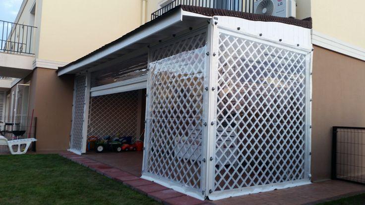 Pergola terasa, inchisa cu pereti transparenti.