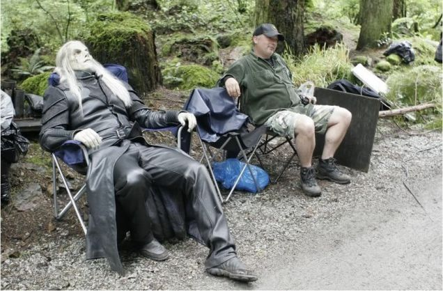 A wraith relaxing on set of Stargate Atlantis. The Most Fascinating Behind-The-Scenes Photos Of Your Favorite TV Shows