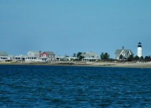 PHOTOS COURTESY OF CHRIS SETTERLUND. The cottage colony and lighthouse at Sandy Neck.