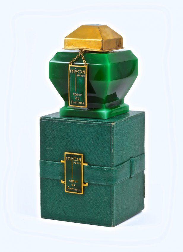 1928 Baccarat, Myon Coeur de Femme perfume bottle, green cased crystal, glass stopper, brass cover and hanging label, green enamel. Baccarat...