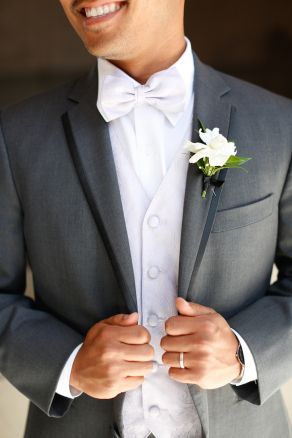 White bow tie with white vest -- chic groom style! | Ryan and Florent's Sweet San Fransisco City Hall Wedding | via Love Inc. | photo by Linda Tran Photography