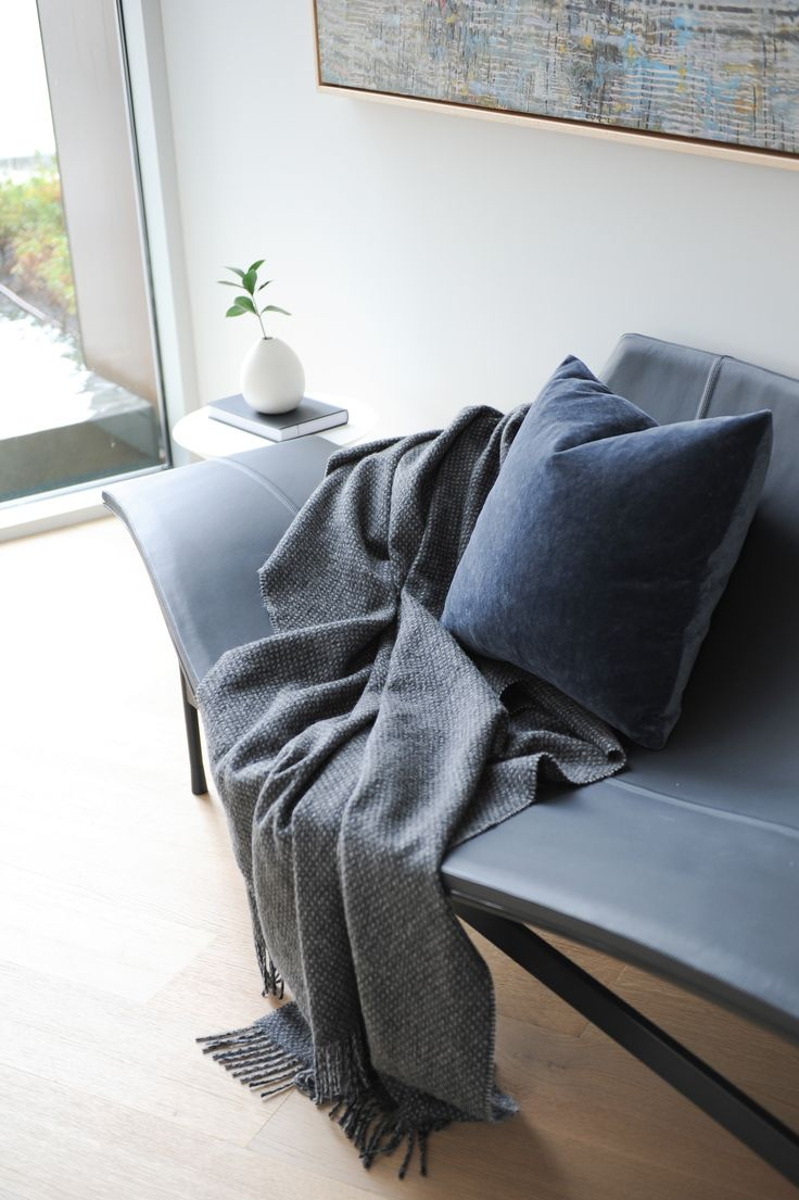 Pillows and throws are great items to put almost anywhere like an entry bench.