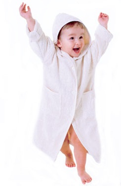 Hooded Dressing Gown.  Beautiful soft, absorbent terry cotton dressing gown.  Made of 100% purest natural unbleached cotton.   Perfect for after the bath and for after swimming.  These cosy hooded dressing gowns are quite unique.  Roomy and designed to fit for a good age span.  They can easily fit for several years! Button closing.