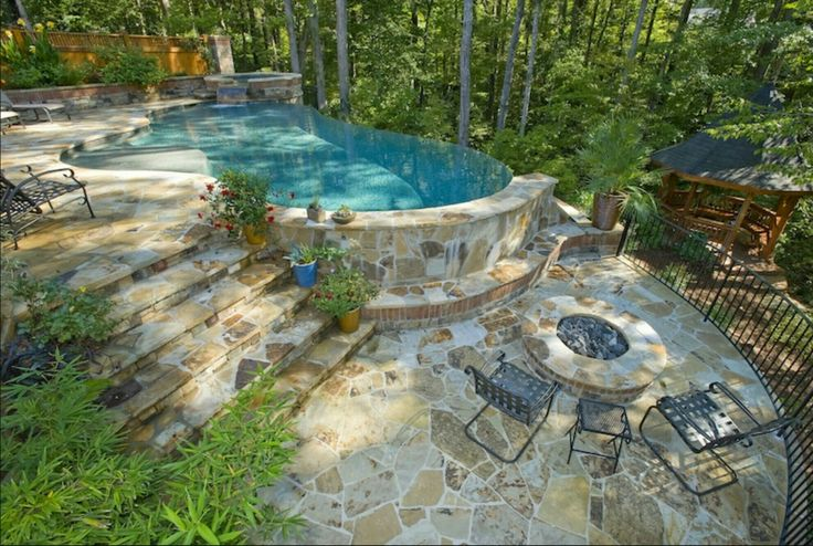 17 best images about log cabin homes on pinterest great for Hillside pool ideas