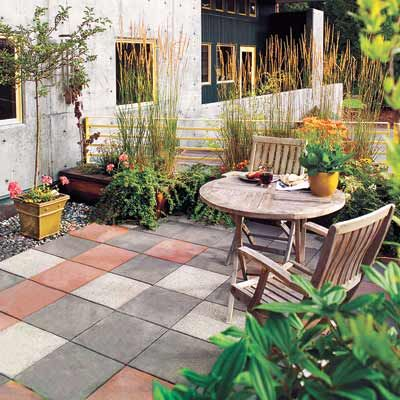 Precast concrete slabs in terra-cotta, charcoal, and soft gray give this patio its distinctive checkerboard look. For a new installation, purchase slabs like these that are tinted during the manufacturing process. Or to liven up existing monotone slabs, you can brush, trowel, or squeegee on a thin layer of Quikrete's DIY-friendly concrete resurfacer (find it at The Home Depot).   Photo: Norm Plate   thisoldhouse.com