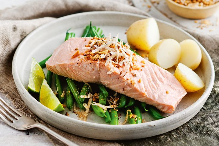 Poach salmon in lime-coconut water until succulent, and serve with almond dukkah.