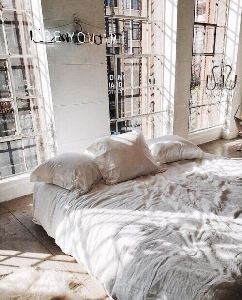 This all white bedroom decor is anything but boring!